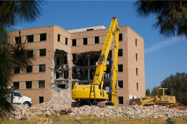Commercial Demolition Project with a big yellow crane
